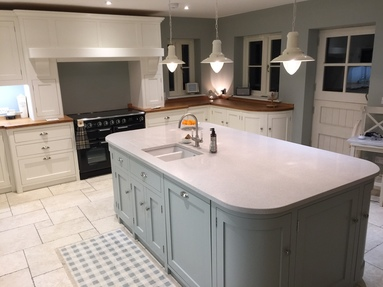 Fully bespoke shaker style kitchen hand built from solid wood finished in Farrow & ball pointing.
