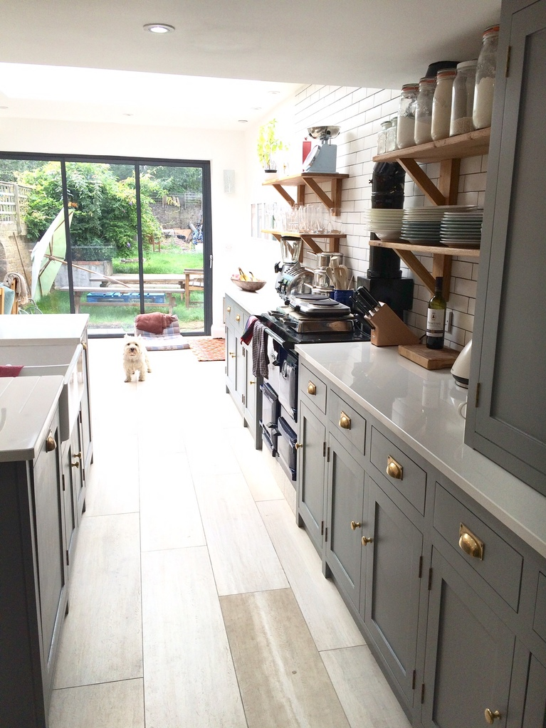 Fully bespoke,shaker style kitchen hand made from solid wood.Feature, individually tailored island site.