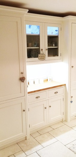Fully bespoke housekeepers cupboard incorporating integrated fridge, hand built from solid wood.