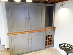 Solid wood shaker style kitchen units hand built with belfast sink.