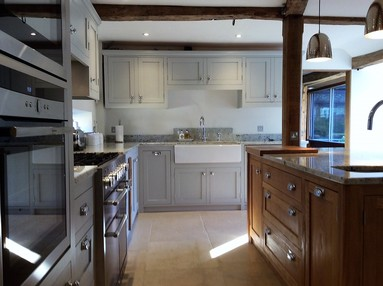 Tailor made  solid wood kitchen in the shaker style bespoke design for Barn in Oxfordshire.Feature solid oak island site ,belfast sink unit.