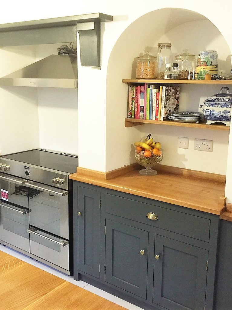 Tailor made, individual design shaker style kitchen hand made from solid wood here in Nottingham,painted in Farrow&Ball downpipe.Bespoke island site with wide plank solid oak surface top.