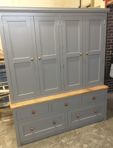Fully bespoke freestanding housekeepers cupboard hand built from solid wood in Nottingham.