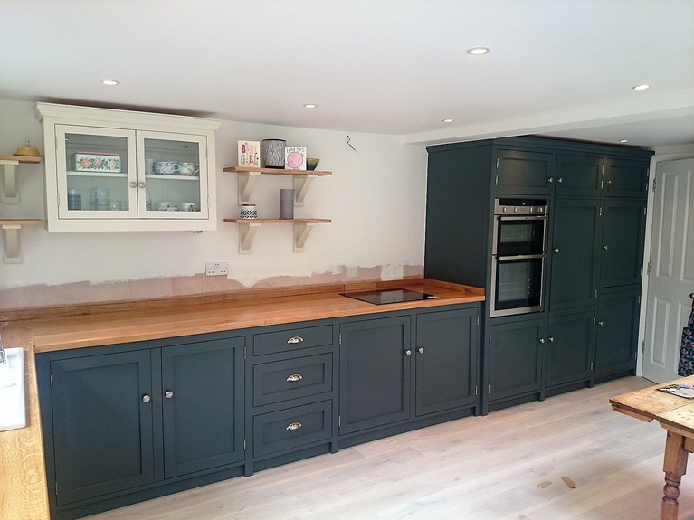 Fulle bespoke,shaker style fitted kitchen hand built from solid wood with wide plank solid oak surface tops.