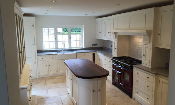 Made to measure solid wood shaker style kitchen in solid wood hand built at our factory in Nottingham Painted in Farrow&Ball Pointing.Bespoke island site with solid wood black walnut top.