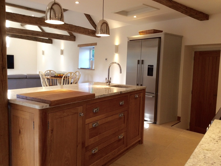 Individually designed island site, shaker style in solid oak.