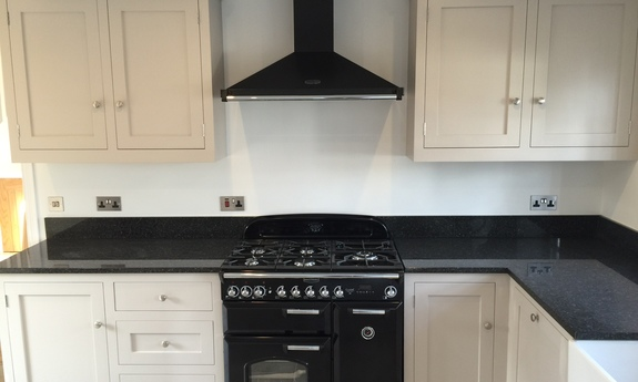 Fully bespoke solid wood shaker style kitchen .hand built in our factory in Nottingham,features double belfast sink,range cooker,tailor made cabinets finished in Farrow&Ball elephants breath.